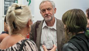 Jeremy Corbyn listens